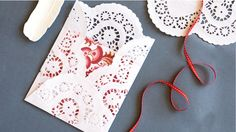 How to make doily envelopes. Try this super simple idea, great for all ages.  By: Francesca Newby, Photography: Amanda McLauchlan, Styling: Rachel Brown