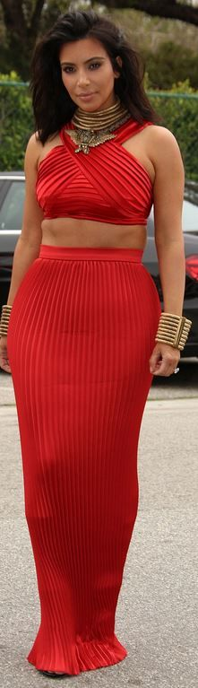 Kim Kardashian's red pleated maxi skirt, gold jewelry, and halter top fashion id