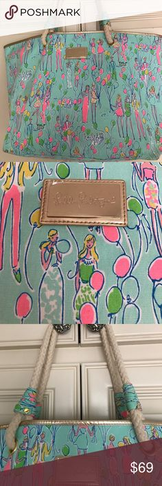 LILLY PULITZER 🎀 Party Pop Shoreline Tote Bag Super cute and holds so much!! Condition is EUC, clean, original plastic covering still on gold LP label in front.  Handles show a bit of use (I bought it this way :). It is not discolored on the inside as the photos seem to show-- bad lighting:(. It's been stored covered in plastic!!   Great Price !! Lilly Pulitzer Bags Totes