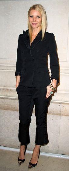 in a black Louis Vuitton suit and metal-cap pumps at the Louis Vuitton Marc Jacobs exhibition in Paris