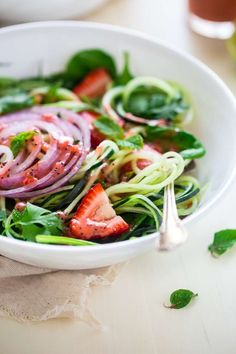 Vegan Spiralized Cucumber Salad with Chia Strawberry Vinaigrette - This healthy cucumber salad recipe is mixed with fresh herbs, strawberries and a homemade lime-strawberry vinaigrette.