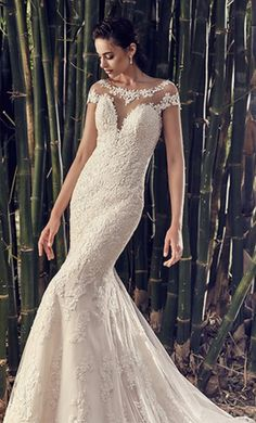 Eddy K Olibia : buy this dress for a fraction of the salon price on PreOwnedWeddingDresses.com