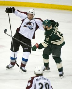 Apr 24, 2014; Saint Paul, MN, USA; Minnesota Wild right Wing Justin Fontaine (14) checks Colorado Avalanche defenseman Jan Hejda (8) in the third period in game four of the first round of the 2014 Stanley Cup Playoffs at Xcel Energy Center. Mandatory Credit: Marilyn Indahl-USA TODAY Sports
