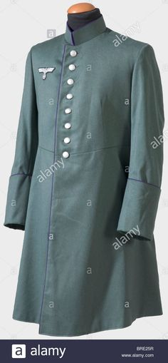 An overcoat for a field chaplain, of the German Army Overcoat of fine, field grey cloth (cut similarly to a cassock) with purple Stock Photo