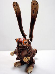 Michihiro Matsuoka. Японский скульптор Мичихиро Матсуока создает восхитительные миниатюрные скульптуры. Объединяя образы животных и технику в одно целое, он превращает их в летательные аппараты и плавающие объекты. Автор 1969 года рождения, берет вдохновение из детских воспоминаний о сломанных устройствах. Для своих работ он использует старые механизмы, глину и акриловую краску. #steampunk #art