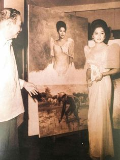 "Someone once asked, ""Who did Amorsolo not paint?"" Somebody answered, ""Imelda Marcos."" But, as can be seen in this photo, National Artist Fernando C. Amorsolo did paint a portrait of Imelda at least once. That painting below the portrait shows President Ferdinand Marcos planting rice, perhaps to promote his government's Green Revolution Program.  They say there's no Imelda Marcos portrait of Amorsolo as this was destroyed or not finished because Imelda didn't like the painting."