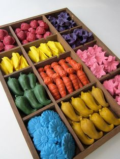 These are handmade, eco-friendly soy crayons!! They have many other shapes too!! Super neat idea.