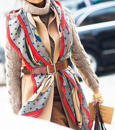 Sweater and vest with belted scarf.