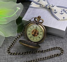 Steampunk Classic Brown case mechanical pocket watch, prefect gift for fathers day gift, groomsmen gift, birthday gift or wedding gifts. Comes with Match Vest Chain. Free gift wrapping, ready for giving.  *****Engraving Options****  For Engraving Font Choices please visit: https://www.etsy.com/ca/listing/495014527/engraving-fonts-and-engraving-samples  Engrave option 1: Engrave on the back glass part with short message or Initials, max 10 letters each line and ma...