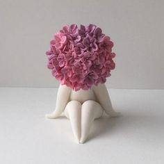 Graceful Flowers Figures in Clay by Carolyn Clayton.England —