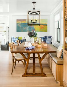 The open dining area's built-in banquette occupies space that was in a walled-off living room in the original house.  #diningroom #diningroomideas #diningroomdesign #kitchennook #homeimprovement #homedecor #diningroomdecor #diningroominspiration #homeremodel #remodel #diningroomremodel #diningroomdesign