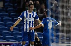 Lewis Dunk (left) is joined by fellow goalscorer Sam Baldock as he celebrates scoring Brighton's fourth goal in the 4-0 humiliation of Leeds United at Elland Road