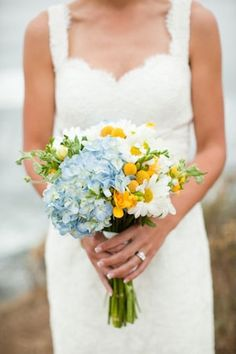 Bridal bouquet designed with hydrangea, freesia, daisies, and billy balls