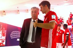 Thomas Mueller of Bayern Muenchen talks to his head coach Carlo Ancelotti at the players tunnel prior to the Bundesliga match between Bayern Muenchen...