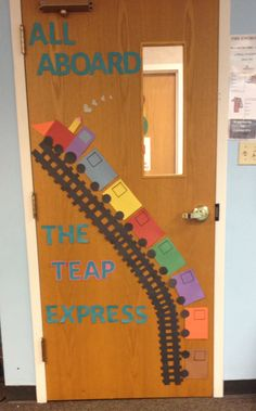 Preschool transportation door decoration. As kids faces to the train cars.