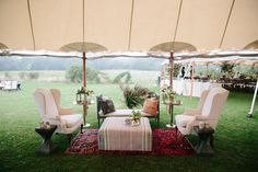 Whitney Weeks and Doug Pickett's Wedding:    The cocktail tent. I had a pretty specific idea of the interior aesthetic, but sourcing vintage pieces was a challenge on Martha's Vineyard. In the end, Reed found us some amazing pieces in New York, which we combined with local Big Sky rentals. Also a shout-out to Lisa Rainis, who facilitated this as well as much of the day! Photo: Lucy Cuneo