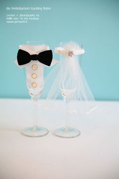 DIY Bride & Groom Toasting Flutes - Decorative tulle and ribbon is all you need to make this memorable wedding craft.