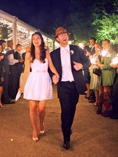 wedding reception exit: go out with a bang! or at least a sparkle. instead of rice or bubbles, give guests sparklers to light as we leave.