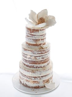 Wedding Cake - semi-naked vanilla cake with white & gold magnolia.