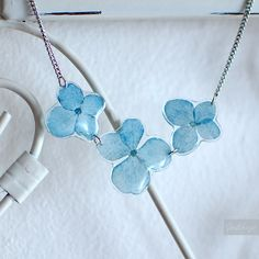 Real hydrangea flowers preserved in resin.