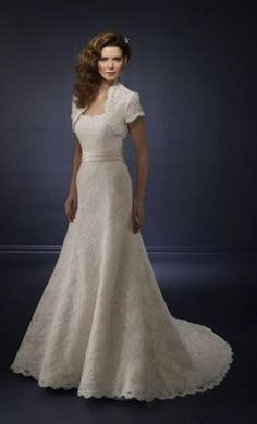Mori Lee 4164, find it on PreOwnedWeddingDresses.com- $700 usd- with shawl and sash