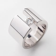 Modern engagement ring design with white diamond by Richard Moser @ DDS Diamonds