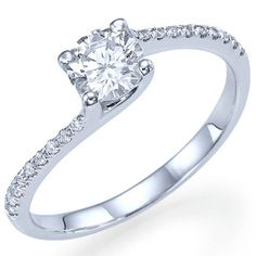 0.60 carats Round Cut Natural Diamond Engagement Ring 14k White or Yellow Gold. $850.00, via Etsy.