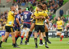 TJ Perenara Photos - Beauden Barrett the Hurricanes scores a try as TJ Perenara celebrates during the round seven Super Rugby match between the Rebels and the Hurricanes at AAMI Park on March 30, 2018 in Melbourne, Australia. - Super Rugby Rd 7 - Rebels Vs. Hurricanes