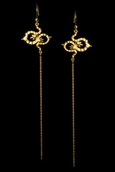 https://www.cityblis.com/4421/item/7371 | Long Kaleido Earrings in Gold - F20 - $558 by ANNIKA BURMAN | Extra long Kaleido earrings in 18ct gold vermeil*. Perfect statement jewellery for evening. These shoulder skimming earrings are also available in silver, with, or without, oxidised detailing.     Length of motif only: approx 30mm / 1.2 inch. Full length of earrings: approx 150mm / 5.9 inches. T... | #Earrings