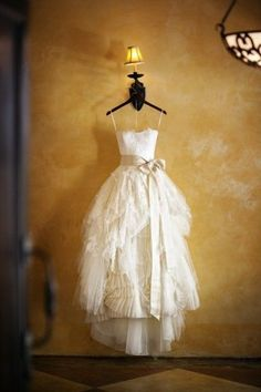 Love this fluffy layered non-traditional wedding dress! And a gorgeous champagne bow