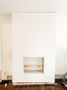 Step by step tutorial on how to build an inexpensive shiplap fireplace using an electric insert. Transform your boring TV wall into a statement piece. Wall Units With Fireplace, Diy Fireplace Mantel, Fireplace Tv Wall, Build A Fireplace, Fireplace Built Ins, Shiplap Fireplace, Rustic Mantel, Fireplace Inserts, Living Room Wall Units