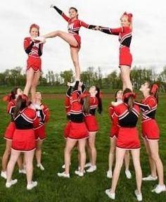 Junior or Varsity high school level stunt/ one legged stunt/ combining stunt/ showcase stunt/ competition or football/basketball game stunts