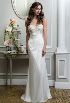 Lillian West. Beaded jersey straight dress complemented by a sweetheart neckline.