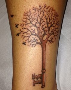 Tree skeleton key tattoo.