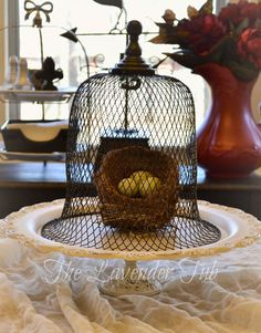 The Lavender Tub: DIY for Wire Cloche from Dollar Store mesh trash can.