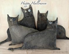 Cat pillows out of old black denim