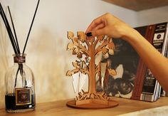 http://sosuperawesome.com/post/143071966894/natural-wood-jewelry-organizer-by-jaukudesign-on