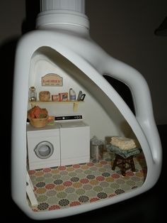 Miniature laundry room in a detergent bottle.