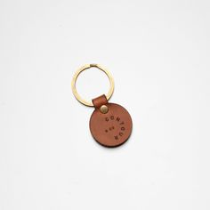 """Leather Key Fob - Fabricated from the off cuts, in order to minimize waste, this little key fob features the contour & co logo, attached to a 1 1/8"""" Antique brass key ring.  Handcrafted in Toronto, Canada.  Boomer Brown Leather  Size: 1"""" Diameter  #leather #keyfob #keyring #fashion #keychain"""