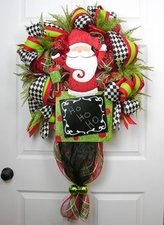A cute Santa with a blackboard to either count down to Christmas, or write a welcome message for your guests. Premium plaid deco mesh and solid red mesh with loops of red/lime green ribbon and harlequ Deco Wreaths, Holiday Wreaths, Holiday Crafts, Holiday Fun, Winter Wreaths, Christmas Projects, Christmas Ideas, 25 Days Of Christmas, Homemade Christmas