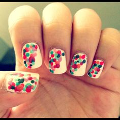 Summer Dot Nails! Apply 2 coats of white nail polish, let dry, then make dots using 5-6 colored nail polishes diagonally. Let dry, apply top coat & voila! :) *hint: overlapping the dots will create more dimension :)