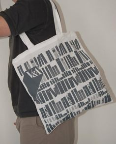 Our bag for the V museum. Custom edge-to-edge print on a white tote bag.
