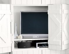 An interesting way of hiding your screen or TV - I'm planning to build something like this