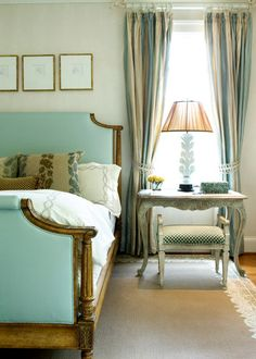 Love the headboard and the smocked heading on the striped drapery panels.