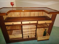 Don't like the different colors of wood, but like the design. Would need a cabinet door with a lock too!