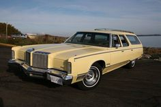 A 1974-1977 Chrysler Town & Country Wagon with a 1978 Chrysler New Yorker Brougham front end with the bodyside wood trim removed.
