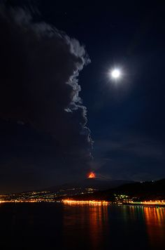 Etna Erupting view from Capotaormina with the lights of Giardini Naxos in the background