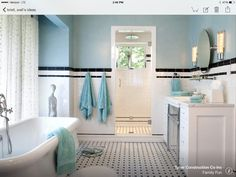 From houzz. Enclosed shower room in front of window.