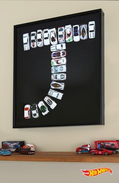 Turn your kid's room into his favorite pit stop with this framed Hot Wheels monogram