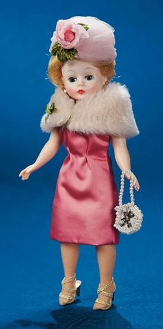 """Blonde Margot in Pink Satin Dress and Plush Stole - 10"""" (25 cm.) Blonde hair,blue sleep eyes,tagged pink satin sheath dress,plush stole with ivory lining,pink tulle hat with rose,stockings,gold sling heels,pearl purse. Excellent condition. Alexander,1957. Z"""